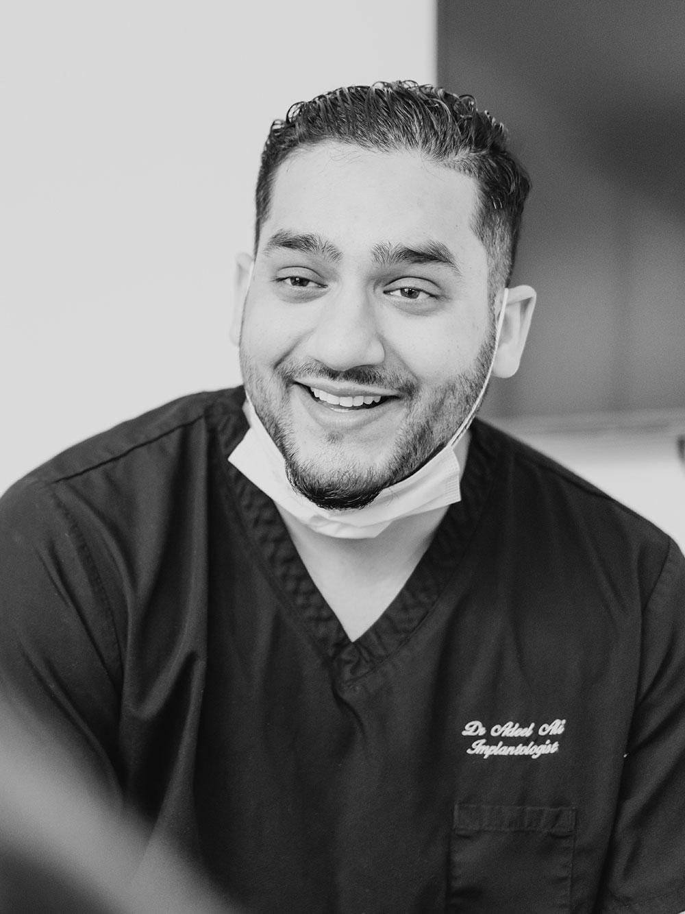 Dr Ali smiling