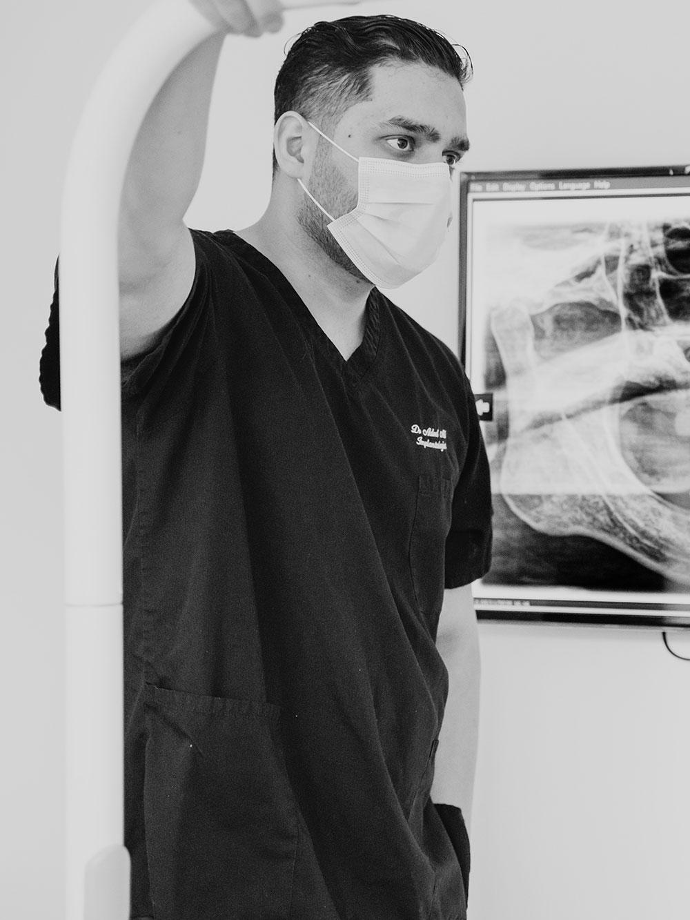 Dr Ali standing in practice